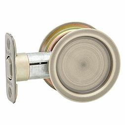 Kwikset 334 Round Pocket Door Lock Antique Brass
